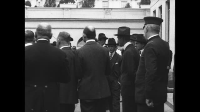 tank britannia arrives at white house / guards move crowd back / president woodrow wilson walks out of white house and gets into tank / president... - wwi tank stock videos & royalty-free footage