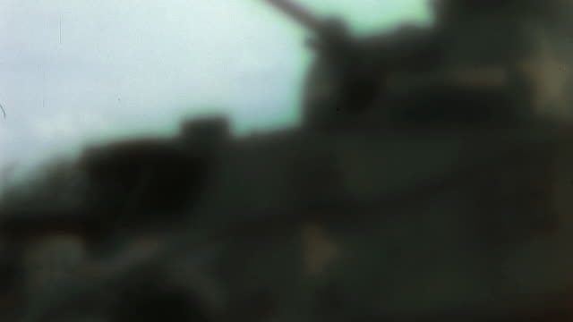 tank convoy crossing the border into tunisia through vichy french barricades during operation torch / tunisia - grobkörnig stock-videos und b-roll-filmmaterial