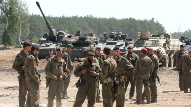Tank crews and soldiers including members of the Norwegian Army Telemark Battalion stand at a roll call during the NATO Noble Jump military exercises...