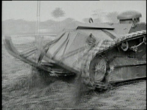 a tank drives across the land and gets stuck in a ditch - kampfpanzer stock-videos und b-roll-filmmaterial