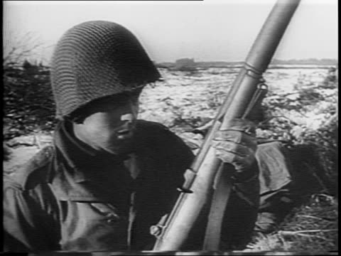 tank driving down road / montage of american soldiers walking down muddy roads / montage of soldiers carrying and laying mines in snowy field /... - allied forces stock videos & royalty-free footage