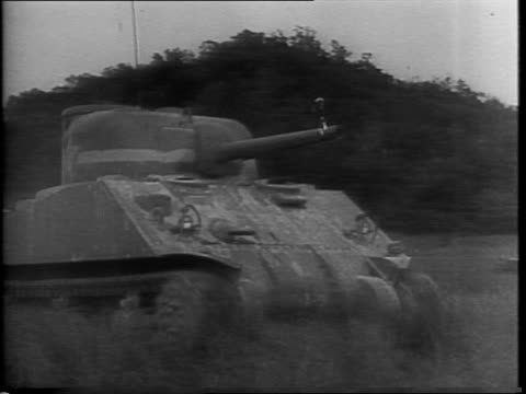 M4 tank driving in field in Fort Knox Kentucky / montage of tank construction at Pullman factory in Hammond Indiana / M4 tanks being transported on...