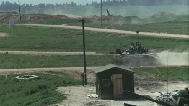 1967 WS HA ZI PAN Tank driving through dirt road during military training