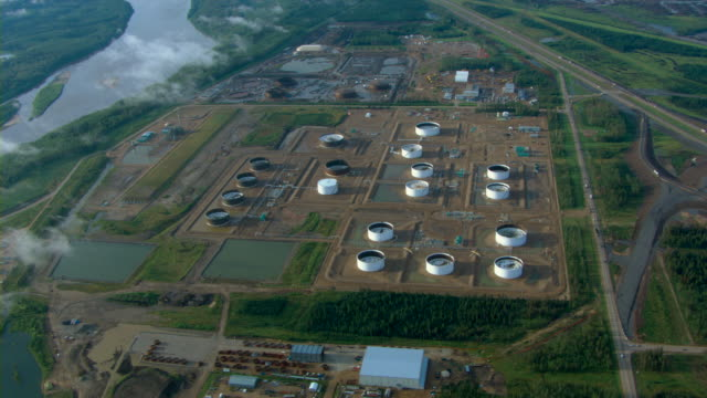 A tank farm sits near an oil refinery near Fort McMurray, Alberta, Canada.