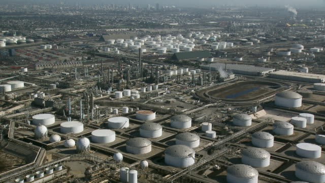 A tank farm with storage tanks containing oil or petrochemical products at an oil refinery in Carson, California.
