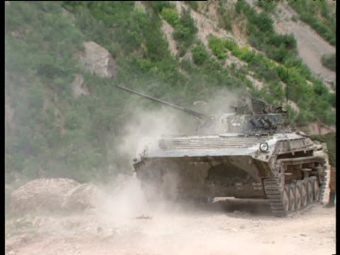 tank fires rounds towards mountains sound echoes round valley tajikistan civil war tajikistan - caterpillar track stock videos and b-roll footage