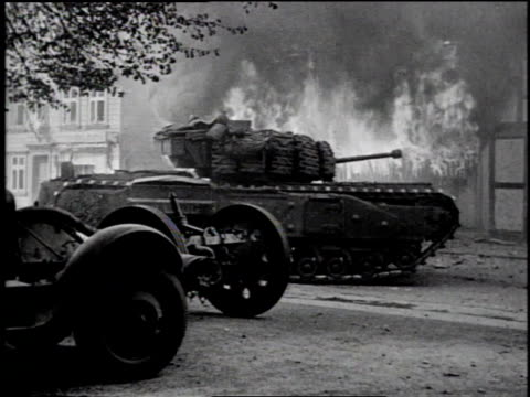 MONTAGE tank fires shell / MS soldiers talk and point amid destruction / WS tank drives through destroyed city with fire in background / WS troops...