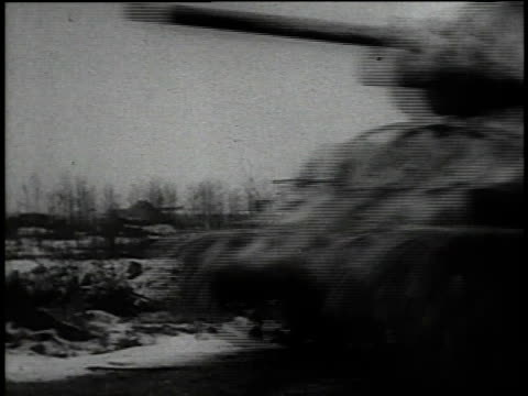 tank following snowy road / tanks moving at high speed through fields - kampfpanzer stock-videos und b-roll-filmmaterial