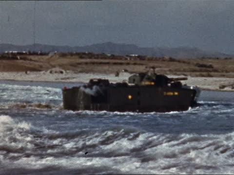 1965 tank landing ship carrying m60 tank moving towards beach - landungsboot stock-videos und b-roll-filmmaterial