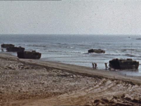 1965 tank landing ships beaching and troops running onto shore - landungsboot stock-videos und b-roll-filmmaterial