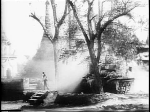 tank mows down tree / british soldiers firing cannons at buildings destroying them / soldier looks through binoculars / japanese soldiers captured - mandalay stock videos and b-roll footage