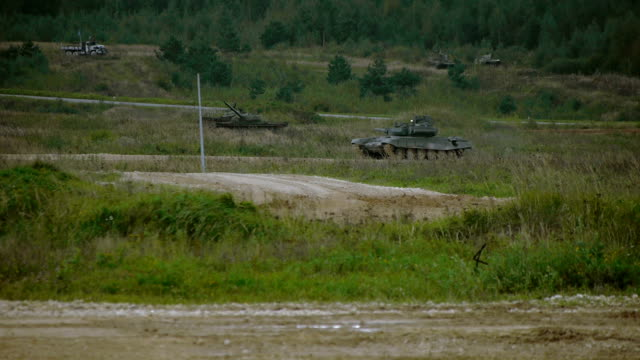 tank on a dirt road - convoy stock videos and b-roll footage