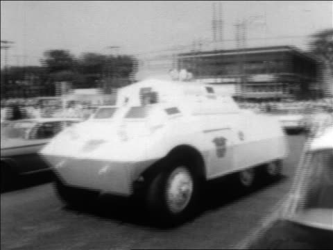 pan tank on street to quash civil rights demonstration / alabama / newsreel - anno 1963 video stock e b–roll
