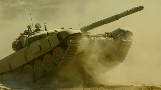 tank overcomes the obstacle course - tank stock videos & royalty-free footage