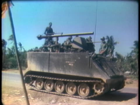 tank patrols pause outside south vietnam villages. - (war or terrorism or election or government or illness or news event or speech or politics or politician or conflict or military or extreme weather or business or economy) and not usa stock videos & royalty-free footage