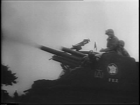 tank rolling through the field / french army soldiers in foreground long road stretching out in front of them / soldiers on tank as tank fires a... - rifle stock videos & royalty-free footage
