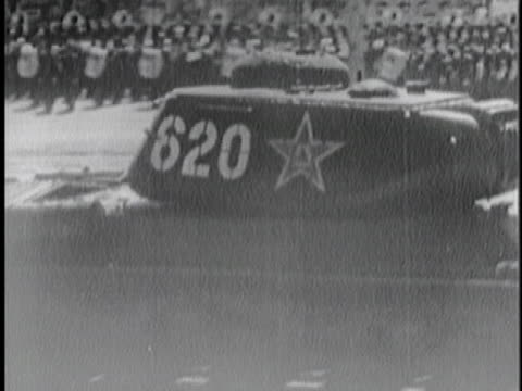 tank rolls by at a military propaganda parade in beijing, china. - 1954 stock videos & royalty-free footage