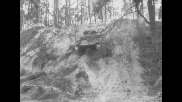 ms tank rolls past / ms tank rolls down wooded hillside taking down trees in the way / vs artillery cannons fire from domed subterranean turrets... - esercito militare francese video stock e b–roll