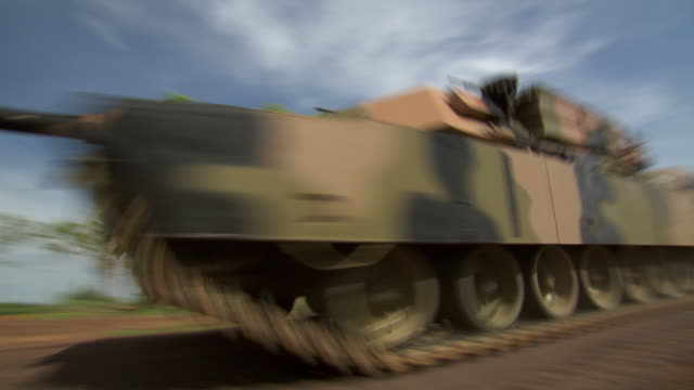 A tank speeds past the camera during a training mission.