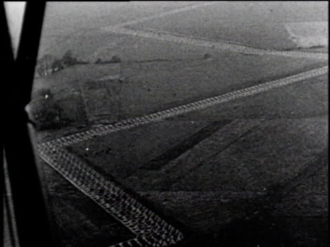 aerial tank traps forming zigzag pattern across landscape below / pilot in cockpit peering at ground - zigzag stock videos & royalty-free footage