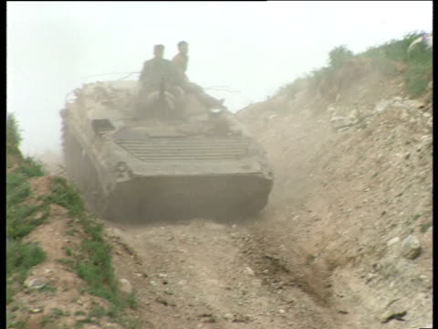 tank travels down steep rugged slope with soldiers on roof during tajikistan civil war tajikistan 1992 - caterpillar track stock videos and b-roll footage