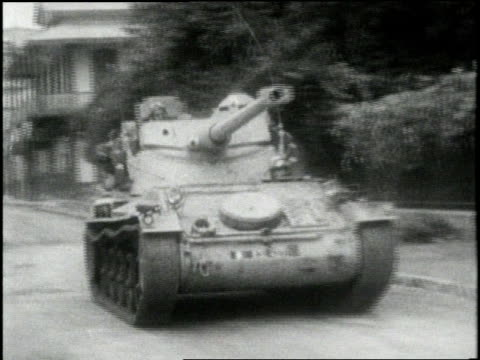 stockvideo's en b-roll-footage met a tank with the words nasser's nightmare rolls through an egyptian street as buildings burn - 1956
