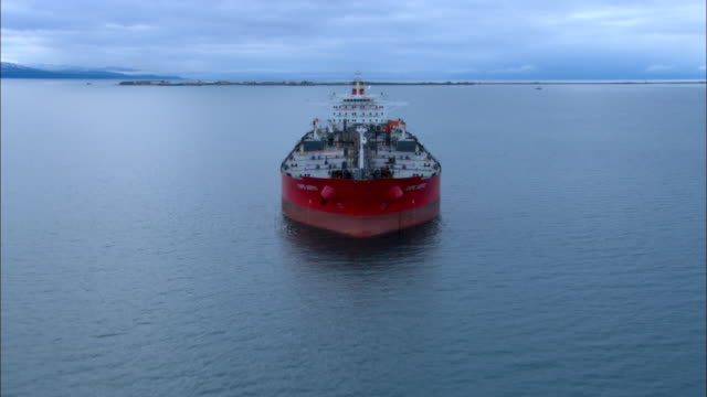 A tanker ship cruises off the coast of Alaska.