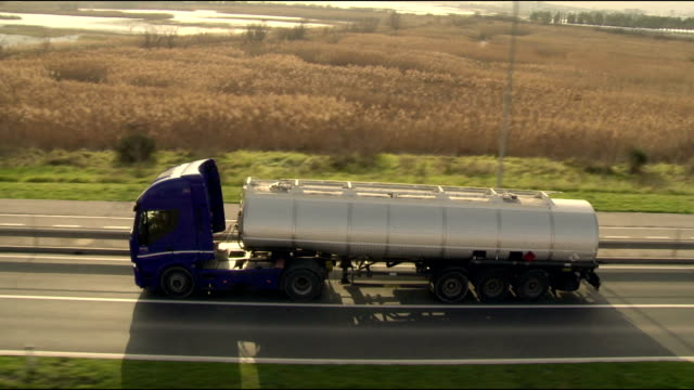 ha ts tanker truck driving on the road - articulated lorry stock videos & royalty-free footage