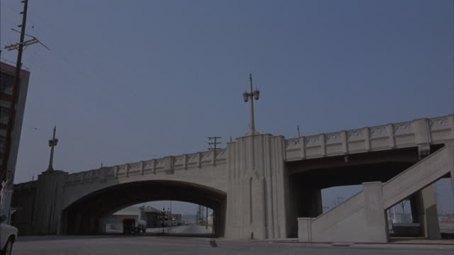 A tanker truck explodes near a bridge.