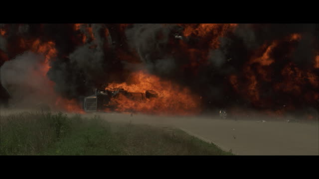 MS, PAN, SLO MO tanker truck falling on road and exploding