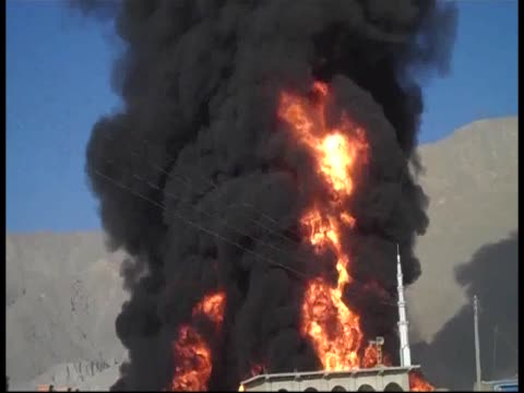 NATO tankers depot burns having been torched in Taliban attack