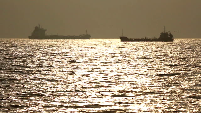 tankers silhouette at sunset - in silhouette stock videos & royalty-free footage