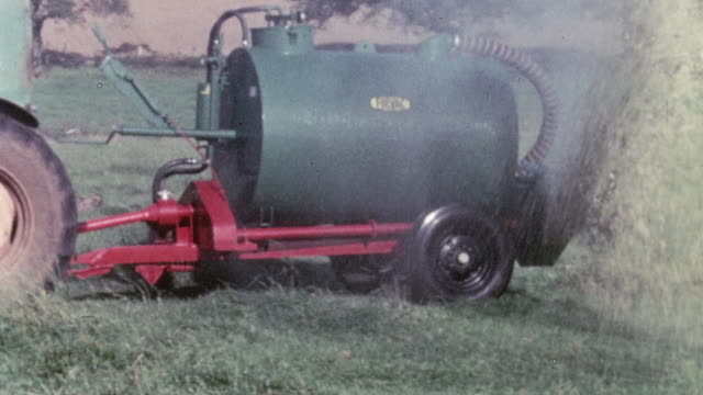 1967 montage tankers spraying slurry over pasture land on the farm / united kingdom - agriculture stock videos & royalty-free footage