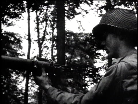 tanks advance across siegfried line / soldiers fire at pillboxes / soldiers crawling / explosion in field - allied forces stock videos & royalty-free footage