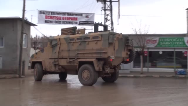 tanks and armoured vehicles carried by military vehicles are sent to syrian border in kilis turkey on march 3 2017 - 軍用輸送車点の映像素材/bロール