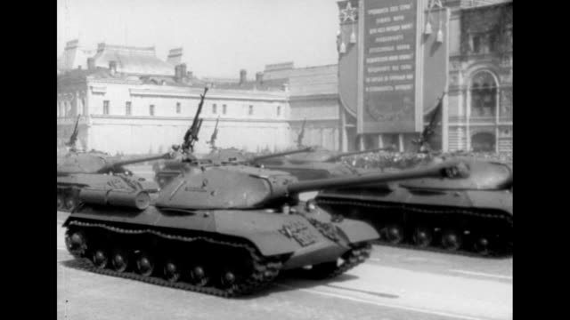 tanks and weaponry roll through red square during a military parade in moscow, soviet union. - former soviet union stock videos & royalty-free footage