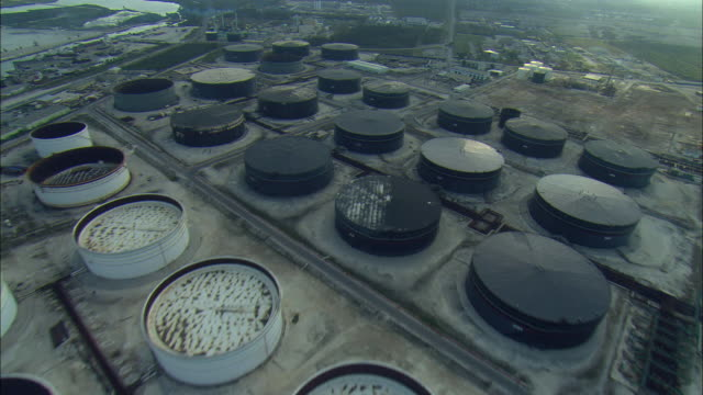 aerial tanks at large crude oil storage facility, freeport, bahamas - fuel storage tank stock videos and b-roll footage