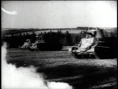 tanks crossing field / pov tank driving in forest / profile of soldier in tank / armored personnel carriers towing artillery - rimorchiare video stock e b–roll