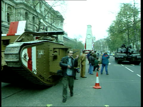 Tanks down Whitehall in Remembrance Ceremony ENGLAND London Whitehall Ext Members of Royal Tank Regiment hold dipped regimental flags by cenotaph at...
