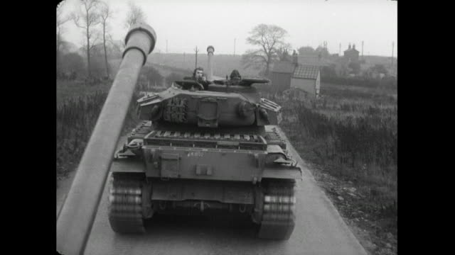stockvideo's en b-roll-footage met pov tanks driving down road; 1956 - britse leger