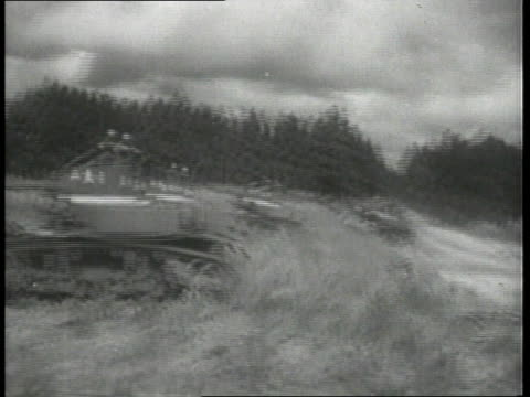 tanks driving quickly over field in second armored division in training camp / fort benning georgia united states - 1951 stock videos & royalty-free footage