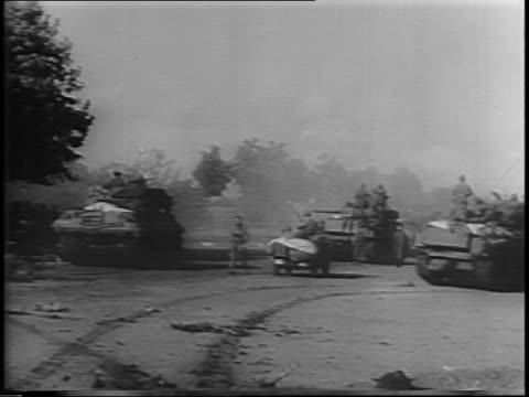 tanks firing pan left to black plumes of smoke rising from ground / tank rolls past fire burning out / medical tank next to sign pointing to... - esercito militare francese video stock e b–roll
