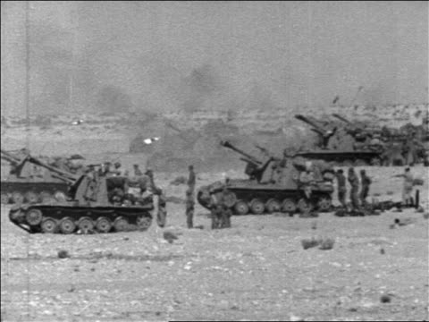 b/w 1967 tanks firing with as soldiers stand by in six day war / middle east / newsreel - sechstagekrieg stock-videos und b-roll-filmmaterial