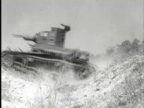 vidéos et rushes de ms, b/w, pan, composite, tanks going though field, one speeding crossing rural road, usa - prelinger archive