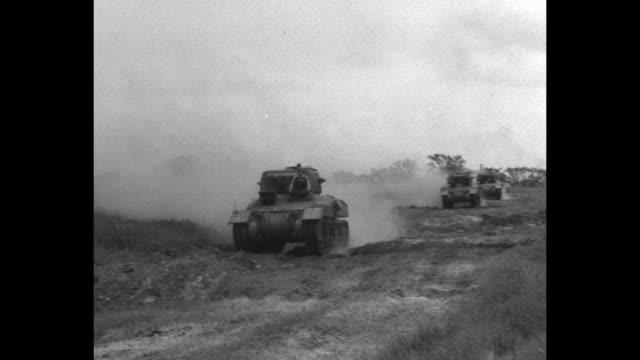 vidéos et rushes de tanks on dusty road / tanks going over rough terrain and mud / note: exact day not know - essai de voiture