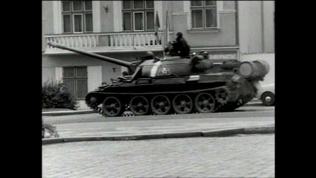 tanks parked on the street; tracking view of airplane flying overhead over the city; view from inside a car of tanks driving down the street with... - prague stock videos & royalty-free footage