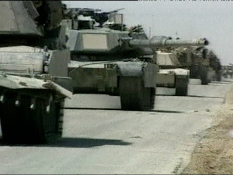 US tanks pass left on road during Iraq war 02 Apr 03