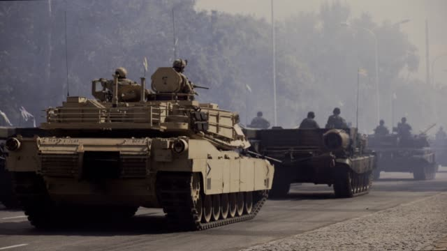 tanks riding along city streets - tank stock videos & royalty-free footage