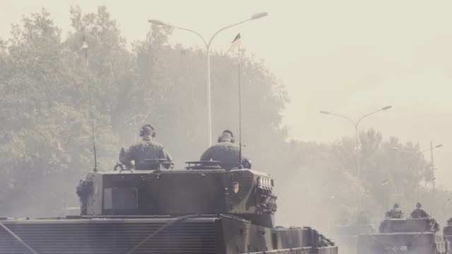 tanks riding along city streets - military parade stock videos & royalty-free footage