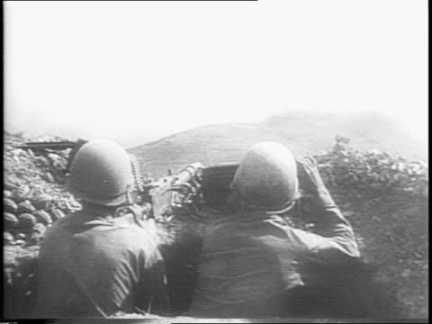 tanks starting to advance on field / two tanks advancing on field / tank hits and man jumps out and runs away from it / two marines wearing helmets... - man and machine stock videos & royalty-free footage